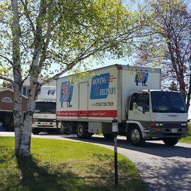 TLC Moving & Delivery trucks in long driveway