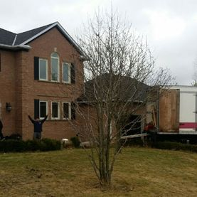 TLC Moving & Delivery truck arriving at destination home
