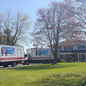 TLC Moving & Delivery truck arriving at customers driveway